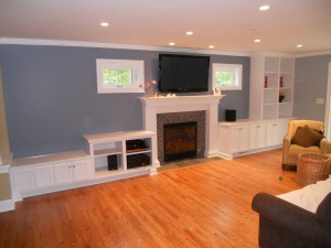 Full wall built-ins with fireplace mantle and surround